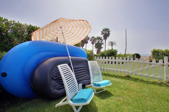 20-Chairs,-towels-and-beach-umbrella
